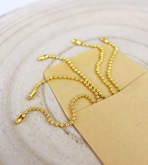cadena de bolitas en dorado